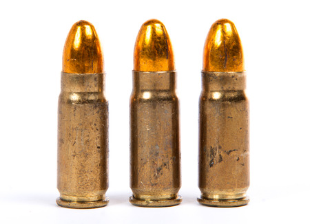three ammunition for firearms on the white background