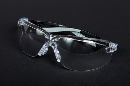 protective glasses: Protective glasses on black fabric Stock Photo