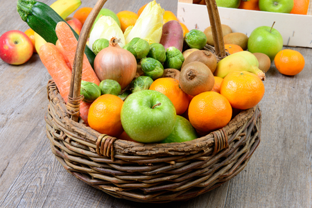 vegetable basket: fruit and vegetable basket on the wooden table