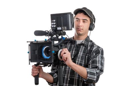 젊은 전문 카메라 맨 및 흰색 배경에 카메라