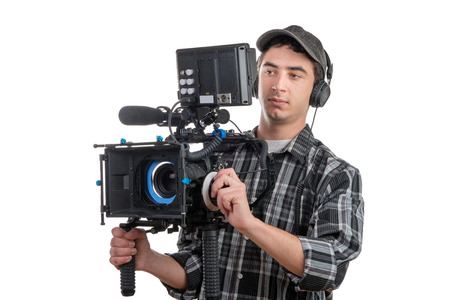 young professional cameraman and camera on the white background
