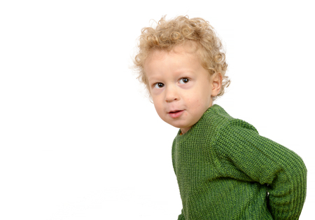 naughty boy: a little boy with a naughty look on the white background