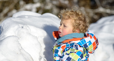 3 year old: little 3 year old child playing in the snow Stock Photo