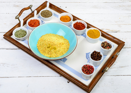 piri: Indian spices assortments on a tray on the white wood en table