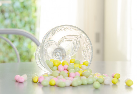 reversed: cup filled with candy for Easter reversed on table Stock Photo