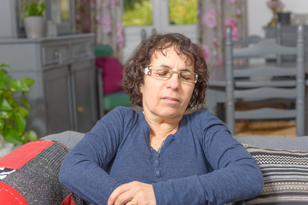 a middle-aged woman has a stomach ache