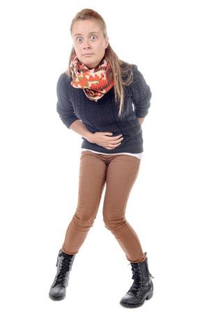 une jeune femme sur blanc a la diarrhée Banque d'images