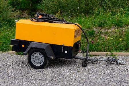 een gele compressor website Stockfoto