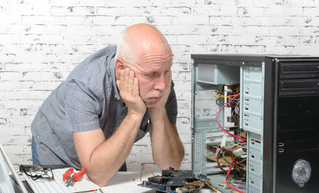 a man has a problem with his computer Stock Photo