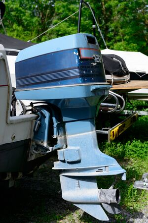 outboard: a blue outboard engine with a propeller