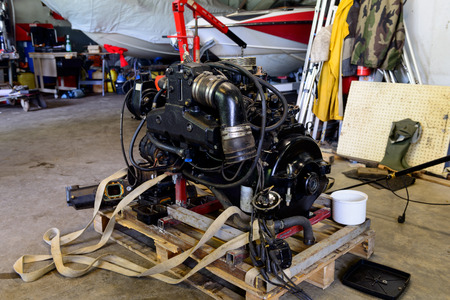 boat engine disassembled in a repair shop Stockfoto