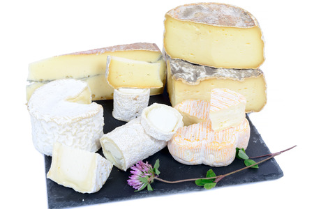 different French cheeses on a plate