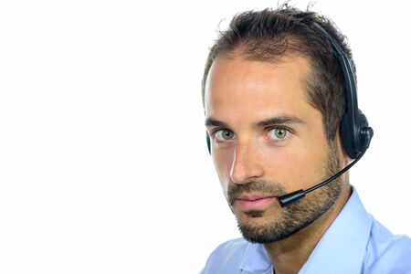 Handsome customer service operator wearing a headset on white background