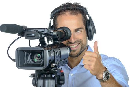 een jonge man met professionele film camera op een witte achtergrond Stockfoto