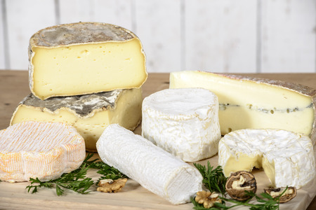 different french cheeses on the wooden table