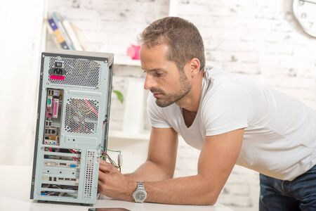 repaired: young engineer repaired a computer