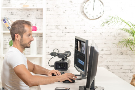 video: video editor with computer and professionnal video camera