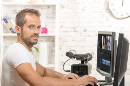 television production: video editor with computer and professionnal video camera