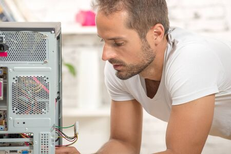 young engineer: young engineer repaired a computer