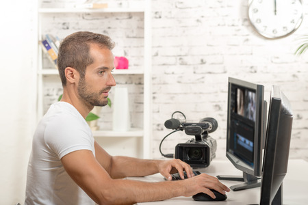 editor: technician video editor on the computer with video camera