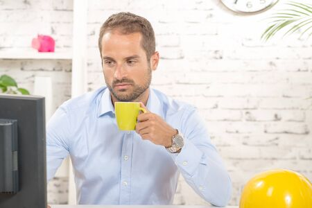 young engineer: a young engineer drinking coffee during the break