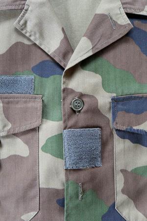 camouflaged: close-up of camouflaged military jacket