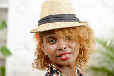 american sexy: portrait of a young African woman with hat