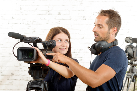 cameraman: young cameraman and a pretty young woman Stock Photo
