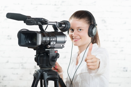 a pretty young woman with a professional camera