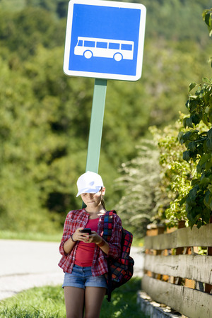 bookbag: school girl with white hat ,waiting bus