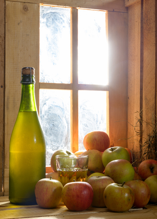 tagged: bottle and glass of cider with apples Stock Photo