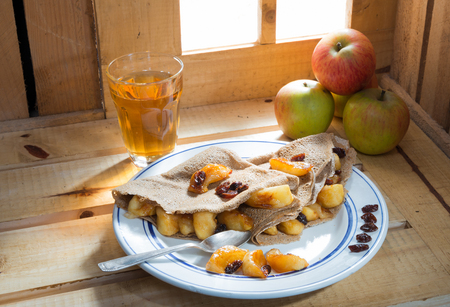 cider: pancakes with apple and a glass of cider