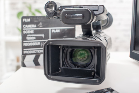 Professional video camera with a clapperboard