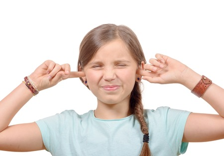 loud noise: girl covering her ears,to say stop making loud noise giving me headache on white background