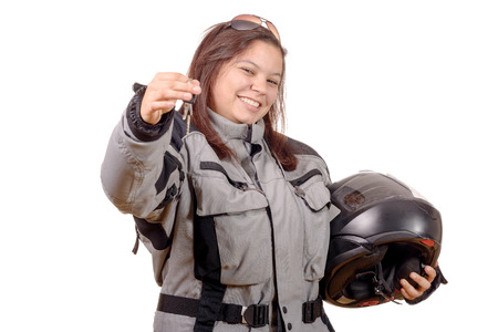 Low key portrait of a girl biker standing on white background