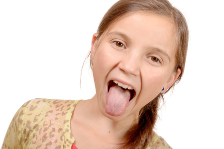 grins: little girl puts out her tongue isolated on the white background Stock Photo
