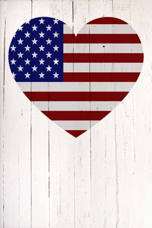 old flag: U.S flag in heart shape on a  old white wooden board