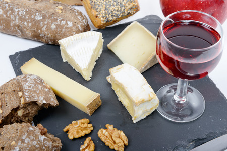 cheese platter: french cheese platter with bread and glass of red wine