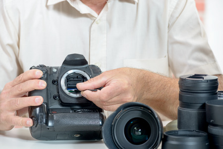 sensor: Close up of hand cleaning photographer de son sensor camera Stock Photo