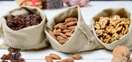 a assortment of dried fruit in small bags canvas