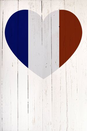 french board: a French flag in heart shape on a white wooden board Stock Photo