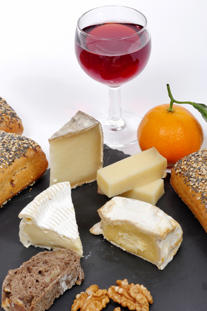 cheese platter: french cheese platter with a glass of red wine and mandarin