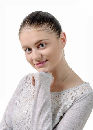 hair tied: a young woman with hair tied isolated on the white background
