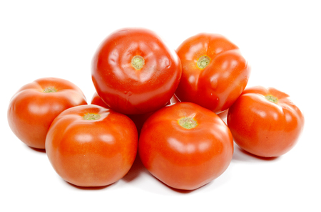 several tomatoes isolated on white background
