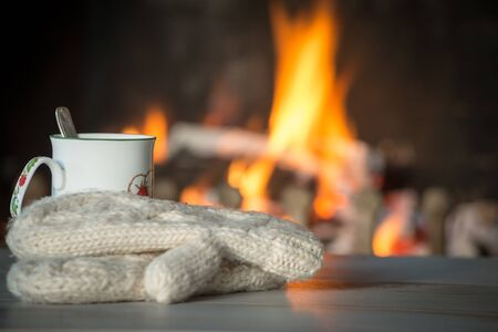 burning fireplace: a cup of tea by the fireplace