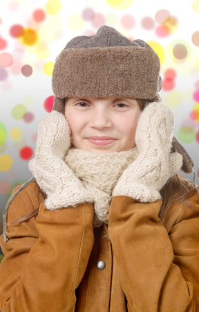 russian hat: a pretty young girl with fur hat, russian chapka style