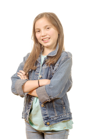 a portrait of a little girl standing with folded hands over white background