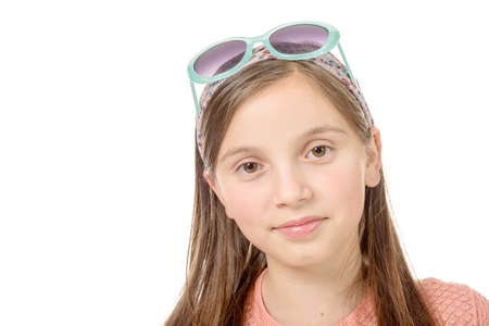 hair band: a portrait of a beautiful, serious girl on a white background