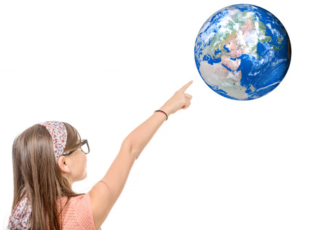 girl studying: a portrait of a smiling little girl pointing finger on world globe on  white background