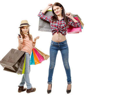 go to the shopping: a beautiful girl and her little sister go shopping during sales Stock Photo